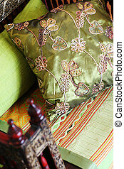 Silk pillow - Close-up of a green oriental silk cushion on a...