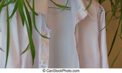 Silk shirt - Man putting on his silk shirt
