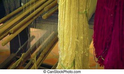 Silk Thread on a Loom in a Cambodian Workshop. Video -...