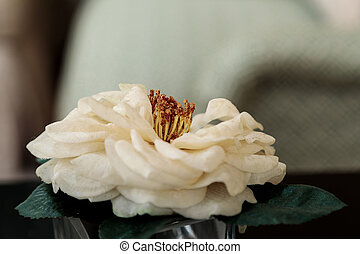 Camellia in vase camellia flowers and foliage in a vase against a silk white camellia flower mightylinksfo