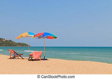 silla de la playa, y, paraguas