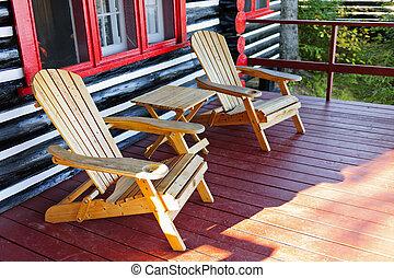 sillas, cabañade troncos, pórtico