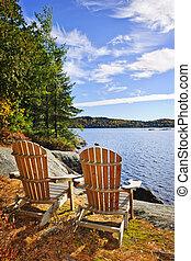 sillas de adirondack, en, orilla de lago