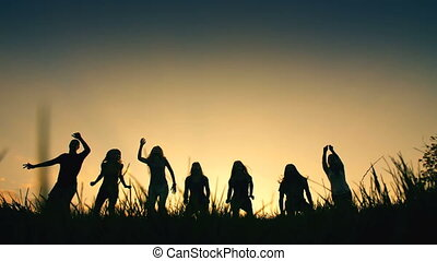 Sillouettes Jumping People - Group of happy friends jumps at...