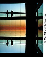 sillouettes - people silhouettes in a modern builing at...