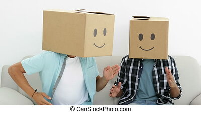 Silly employees with boxes on their heads doing the robot in...
