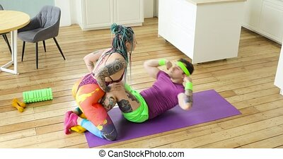Silly fitness humor, man doing abs exercises crunches with ...