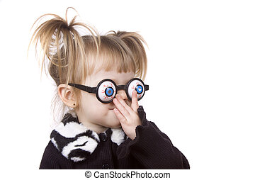 Silly Glasses - A cute little toddler girl wearing silly eye...