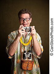 Nerdy pacific island tourist with a silly grin, camera and binoculars