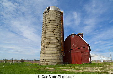 silo and barn - old concrete silo with red barn