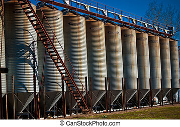 silo perspective - row of silos with rusty stairs