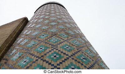 Silo with Designs on Wall - Handheld, panning, exterior, low...
