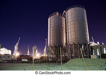 Silos - Construction site with silos by night