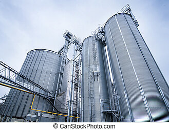 Silos for storage of grain, silo roof close-up. Warehouse of wheat cereals. View from bottom.