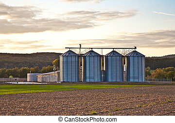 Silos in sunset with beautiful view over acres