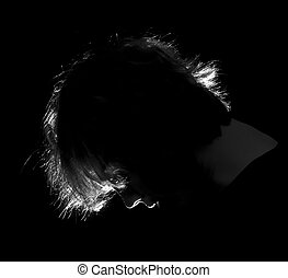 Silouette of a head bowed in prayer
