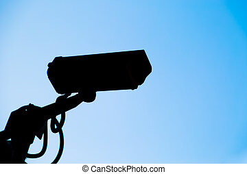 Siluate CCTV camera with bluesky background