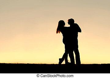 silueta, bailando, pareja, joven, ocaso, feliz