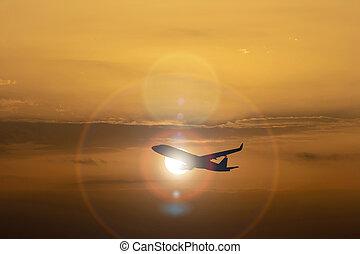silueta, de, avião, ligado, coloridos, céu dramático, em, pôr do sol