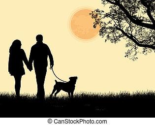 silueta, de, un, emparéjese andando, su, perro, en, ocaso