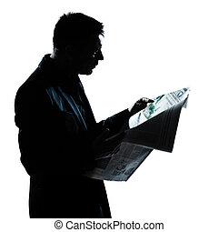 silueta, hombre, retrato, periódico de la lectura