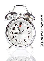 Silver Alarm Clock on a white background.