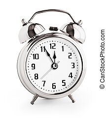Silver alarm clock showing twelve hours with clipping path with no shadows included