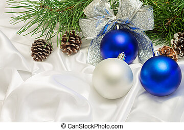 silver and blue Christmas balls with beads and pine branch close