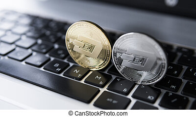 Silver and Gold Dash Cryptocurrency on laptop keyboard....