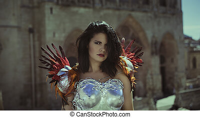 Silver armor, Beautiful brunette woman wearing gold and copper corset in goddess and warrior poses. fantasy and imagination concept