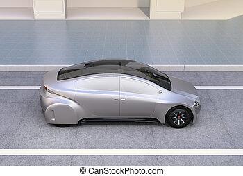 Silver autonomous car driving on the road