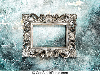 Silver baroque picture frame on grungy background