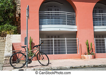 Silver Bike by Pink Wall