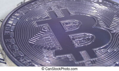 Silver Bitcoin Coin Cryptocurrency, BTC Rotate on Background with US Dollars