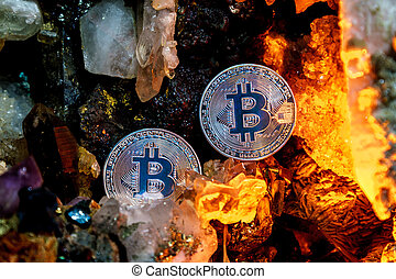 Silver bitcoin in a cave of gem stones