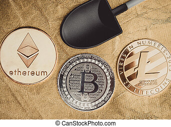 Silver bitcoins ,litecoin, ethereum crypto coin with black shovel mining on golden rough ground texture, Cryptocurrency virtual digital money