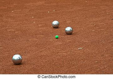 Silver boccia balls on the ground