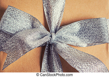 silver bow on gift box