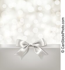 silver bow ribbon and light effects blurry background. ...