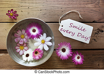 Silver Bowl With Label Life Quote Smile Every Day With Purple And White Cosmea Blossoms On Wooden Background Vintage Retro Or Rustic Style