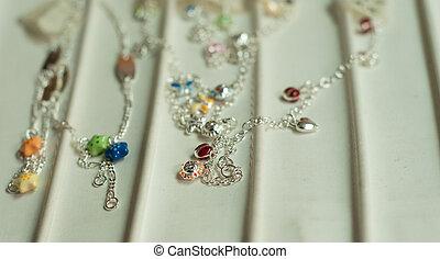 silver bracelets on white background