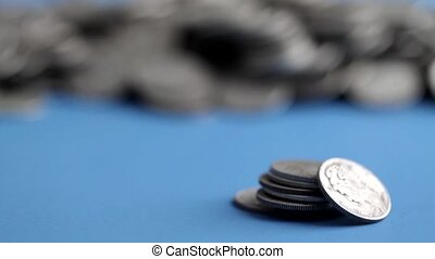 Silver bullion dimes on blue table - Video of a small stack...