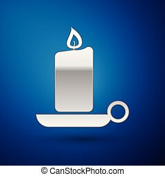 Silver Burning candle in candlestick icon isolated on blue background. Old fashioned lit candle. Cylindrical aromatic candle stick with burning flame. Vector Illustration
