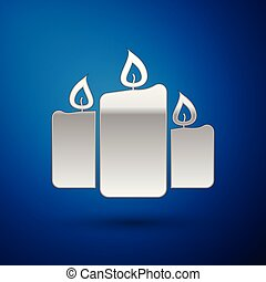 Silver Burning candles icon isolated on blue background. Old fashioned lit candles. Cylindrical aromatic candle sticks with burning flames. Vector Illustration