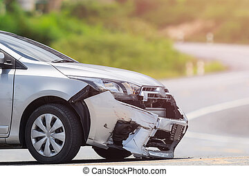 Silver car get damaged by crash accident on the road. Car repair or car insurance concept