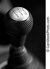 silver car stick with 5 speeds - Car's shift lever. Macro...