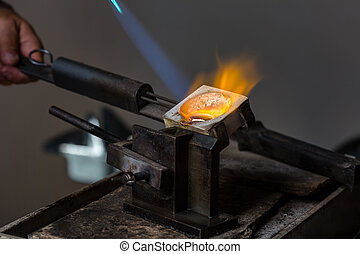 Silver Casting from Crucible to Metal Mold - Close-up of...