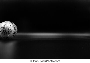 Silver Christmas balls on black background.
