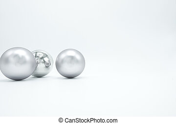 Silver Christmas balls on white.