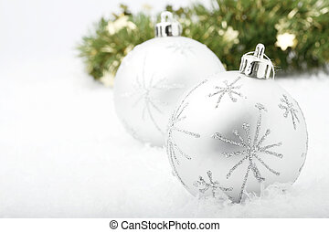 Silver Christmas baubles.